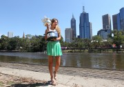 Виктория Азаренко, фото 178. Victoria Azarenka Posing with the Australian Open Trophy along the Yarra River in Melbourne - 29.01.2012, foto 178